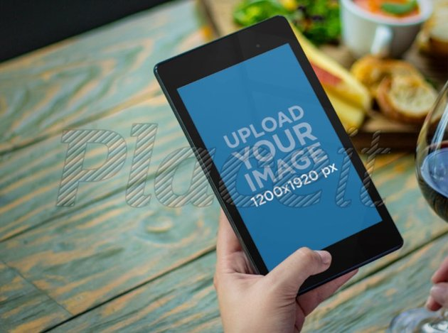 Nexus 7 Mockup Featuring a Woman at a Bistro