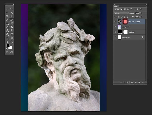 Add a layer  mask to the Greek God layer