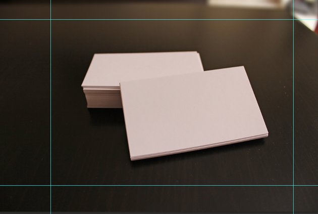White Business Cards on dark brown table Crop Guides in Photoshop