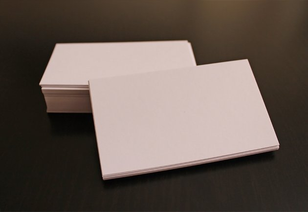 White Business Cards on dark table cropped and clean photo