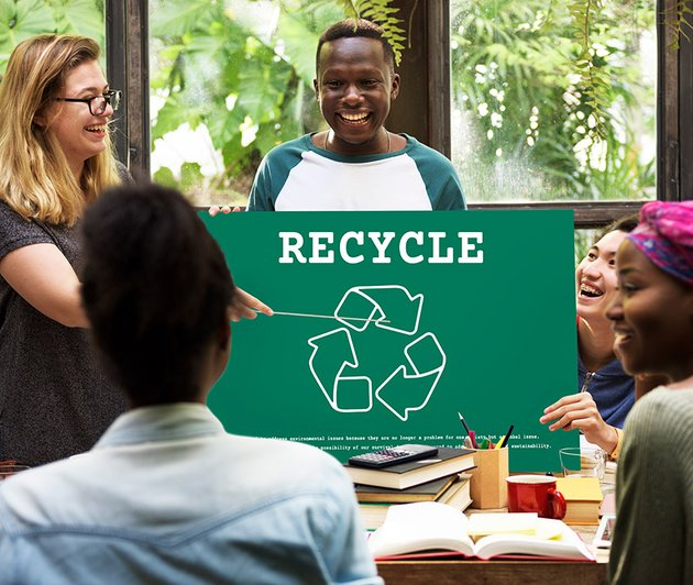 Discussing recycling a high-quality royalty-free stock photo from Envato Elements