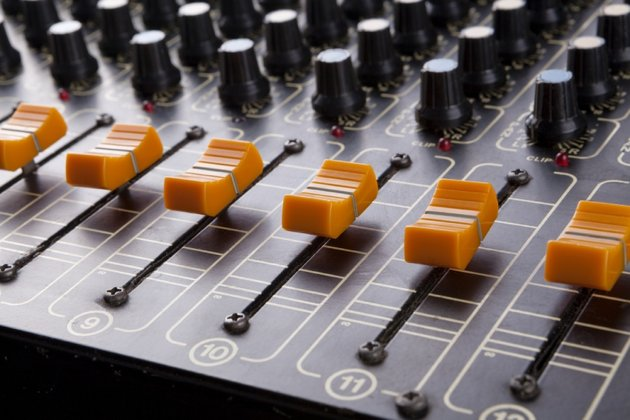 The switches and knobs of a mixing desk