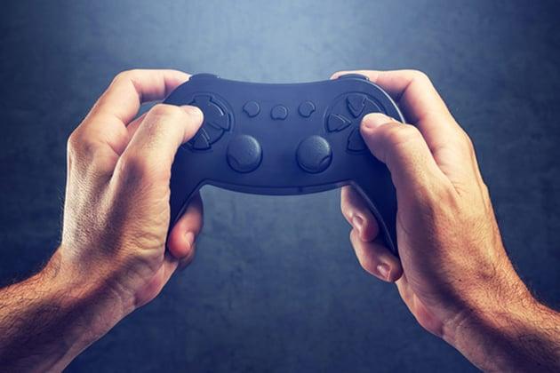 hands grasping a gaming control pad