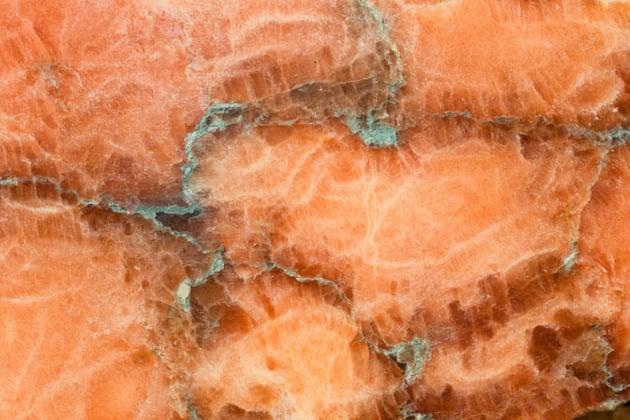 Macro photograph of orange and green crystal