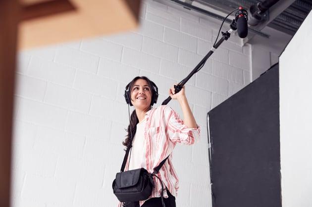 Woman sound recordist in video studio