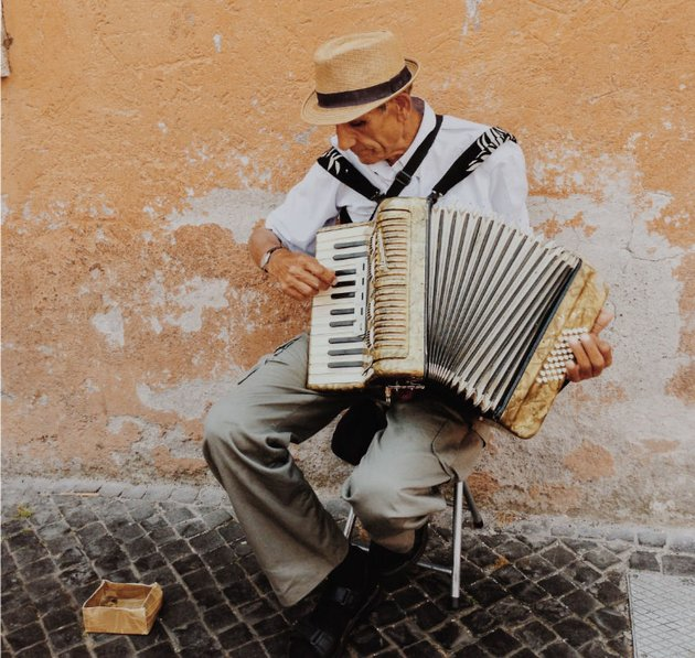 Musician plays an accordion, Italy.