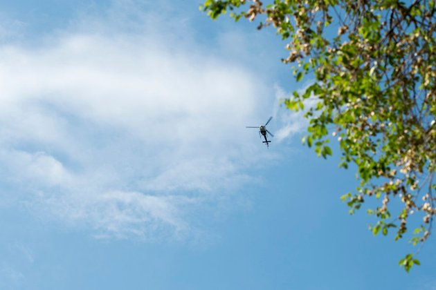 News helicopter flies over protest against police violence , Minneaspolis, Minnesota, May 26, 2020