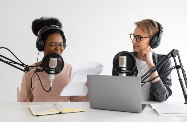 Podcasters reading in a studio