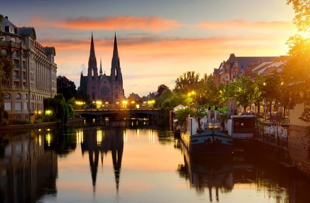 Church viewed across a canal at sunset