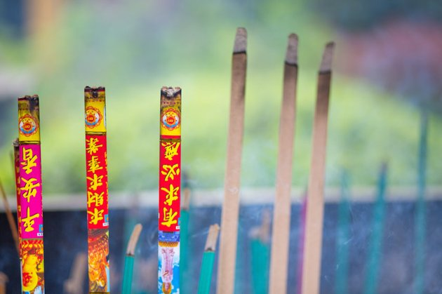 burning incense sticks in a temple