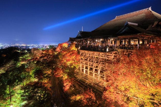 Kiyomizu dera temple at night with the city of Kyoto in the distance