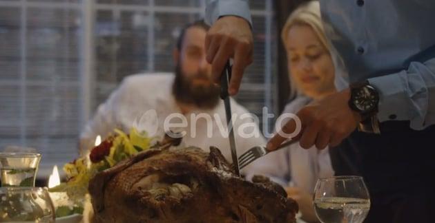 Man Carving Turkey on Holiday Dinner