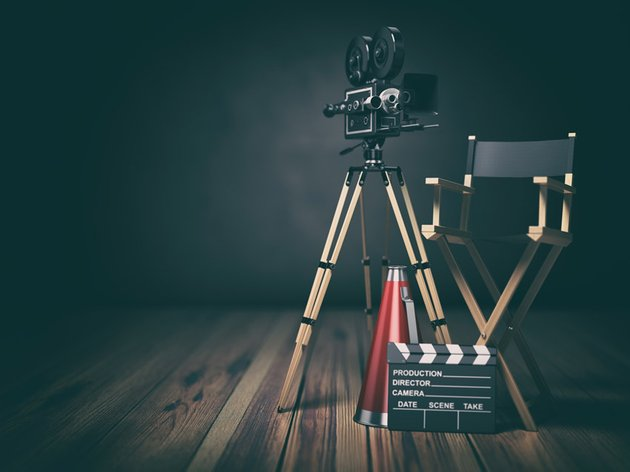 Video movie cinema concept Retro camera clapperboard and director chair 3d