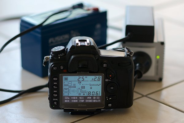 Nikon D7000 camera connected to a 150 Watt inverter that is running a Nikon EH-5a AC Power Supply Unit