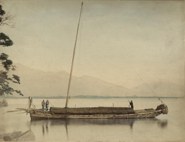 Hand colored photograph of a Japanese boat on the water