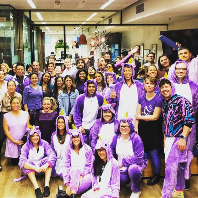 LGBT advocates in action Envato employees on Wear It Purple Day