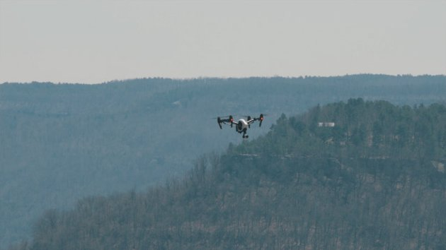 Drone in flight over mountains