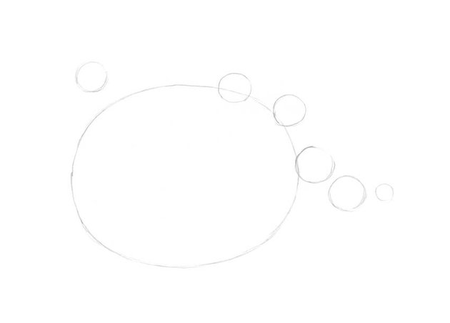 Sketching a rought oval shape and small circles