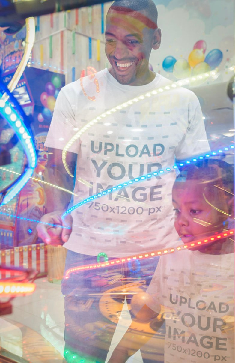 Mockup of a Man Wearing T-Shirts with his Son at the Video Arcade