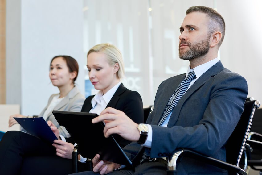 People in business meeting audience