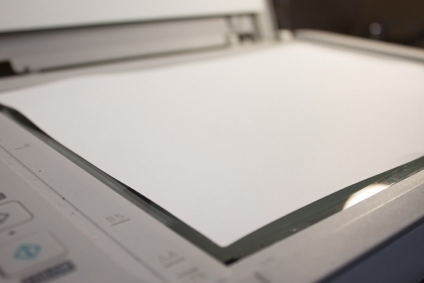 Putting paper into the scanner