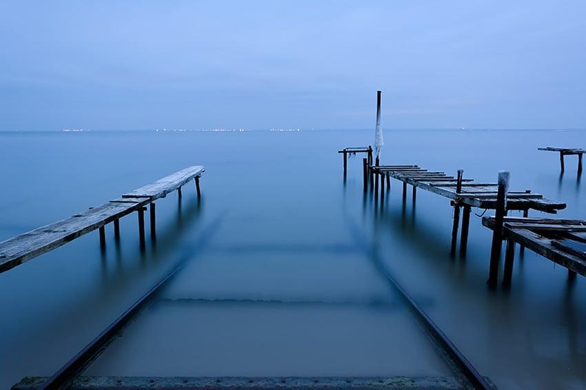 Abandoned wooden bridge over water