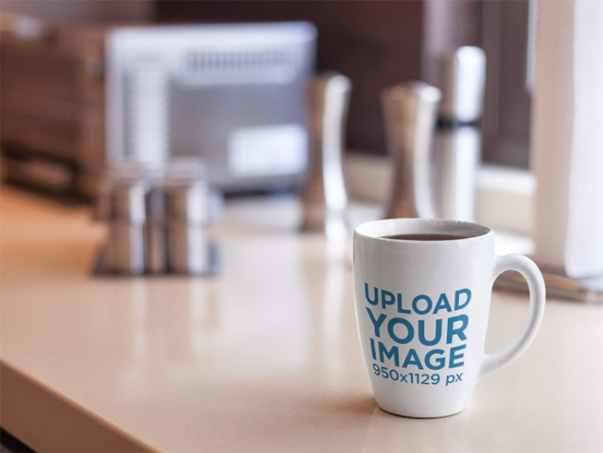 Cup Mockup Featuring a Coffee Cup on Top of a Kitchen Counter