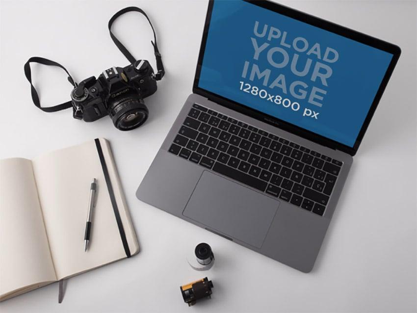 MacBook Pro Mockup Lying on a White Desk