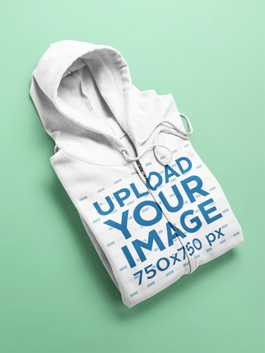 Flat Lay Mockup of an Angled Full Zip Hoodie Over a Surface