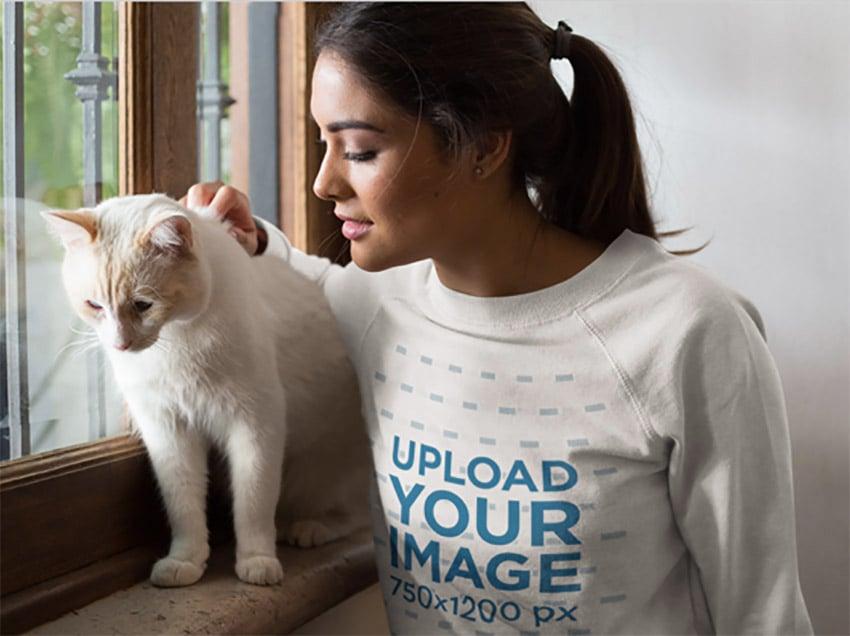 Closeup of a Woman Wearing a Crewneck Sweatshirt Mockup With a White Cat