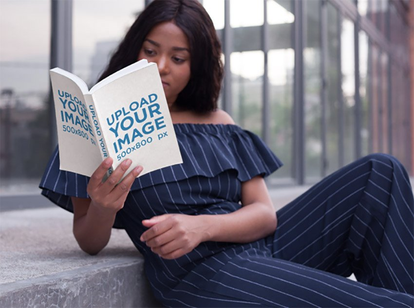 Beautiful Woman Reading a Book Mockup While Posing