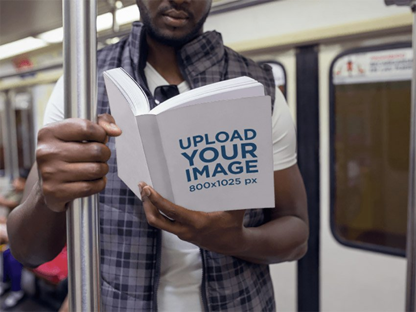 Book Mockup Featuring a Man Reading on the Metro