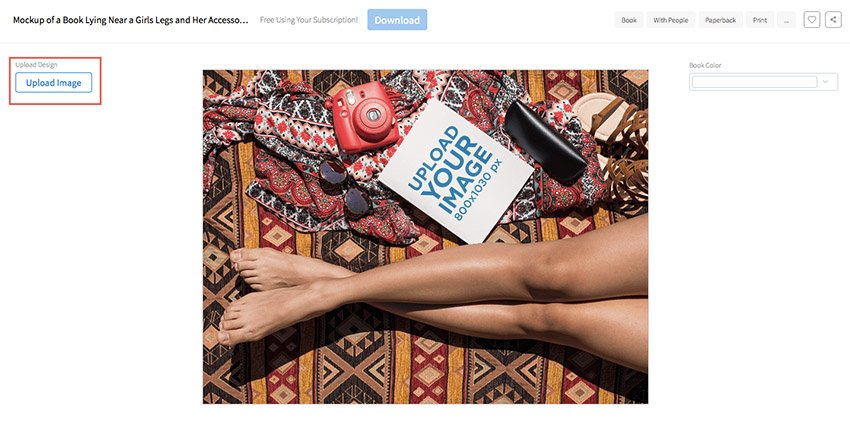 Mockup of a Book Lying Near a Girls Legs and Her Accessories While at the Beach