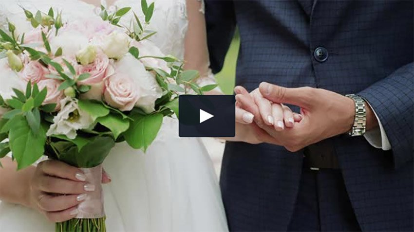 Newly Married Couple Holding Hands Close-up