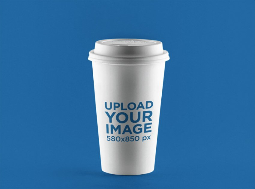 Label Mockup Featuring a Coffee Cup Standing Over a Solid Backdrop