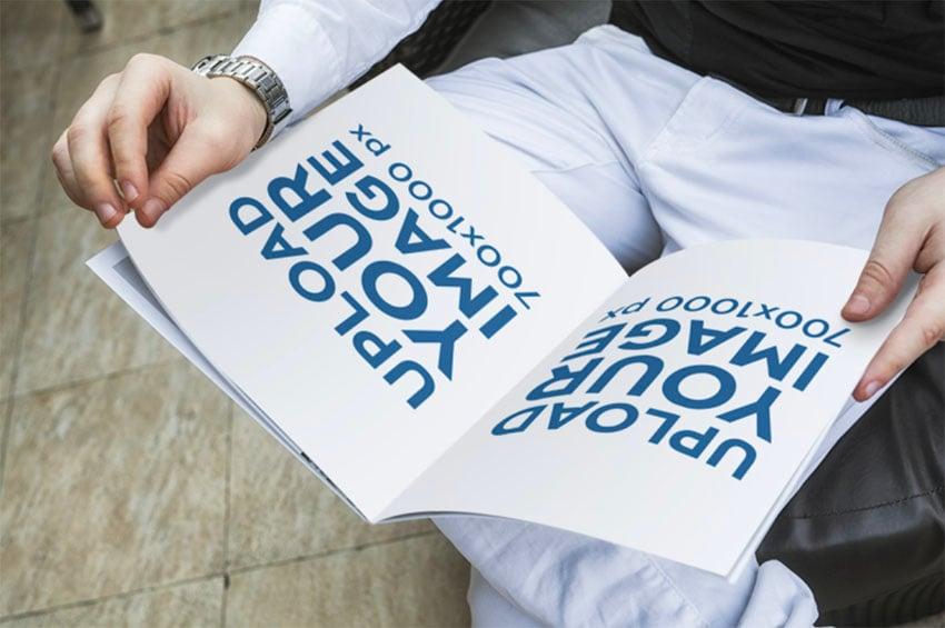 Magazine Ad Mockup Featuring a Man Reading