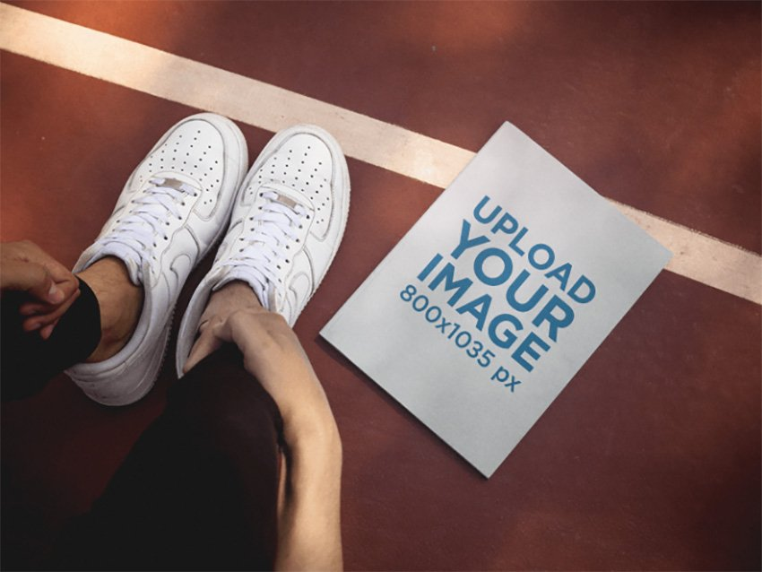 Magazine Lying on a Running Track Beside a Guy White Shoes Mockup