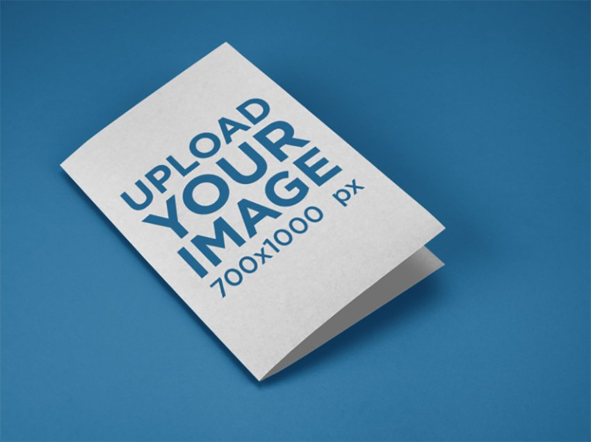 Mockup of a Bifold Brochure Lying on a Solid Color Surface