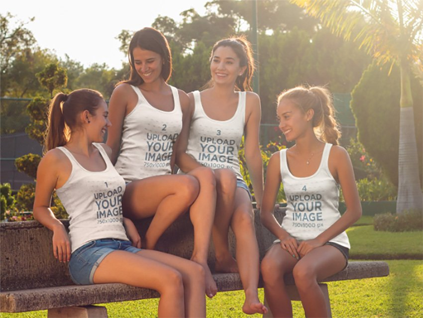 Group of Four Women Having Fun Talking at a Park While Wearing Different Tank Tops Mockup