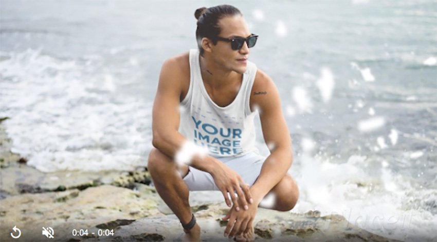 Surfer Guy Wearing a Tank Top Cinemagraph Mockup at a Rocky Shore