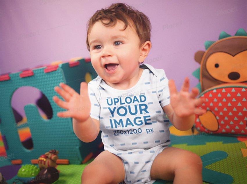 Happy White Baby Boy Clapping While Sitting Down Wearing A Onesie Mockup