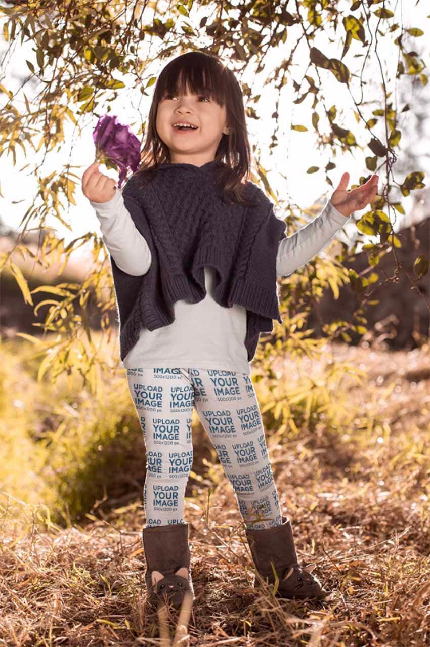 Mockup of a Cute Girl Wearing Leggings Holding a Flower