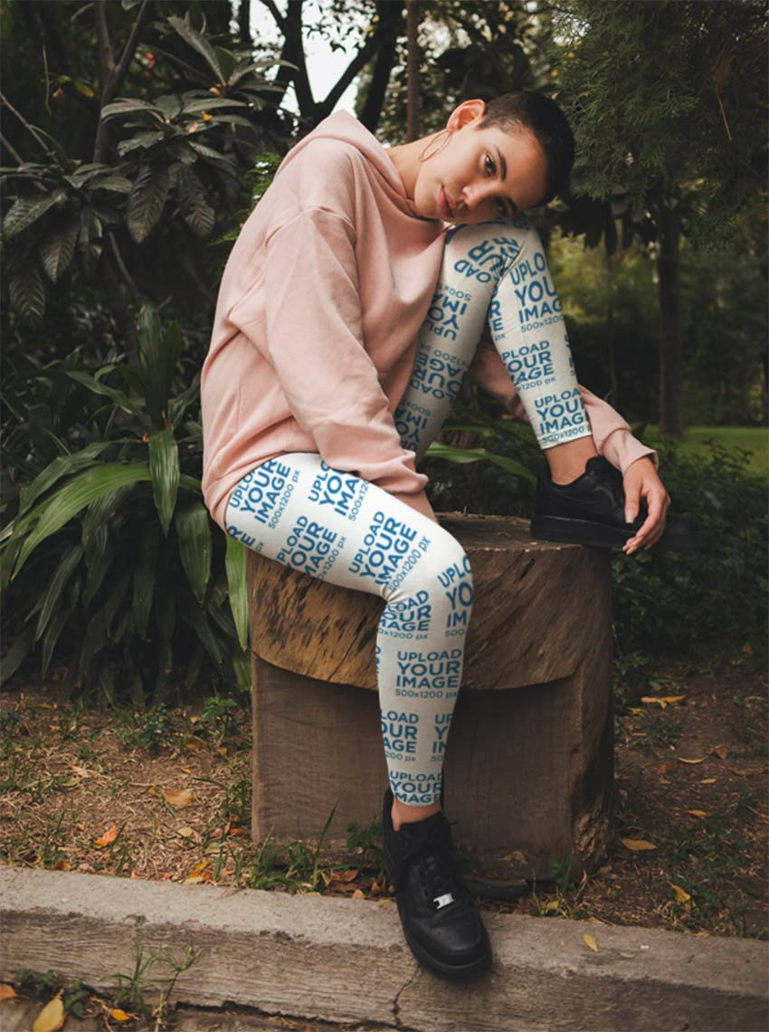 Mockup of a Trendy Woman Wearing Womens Leggings at a Park