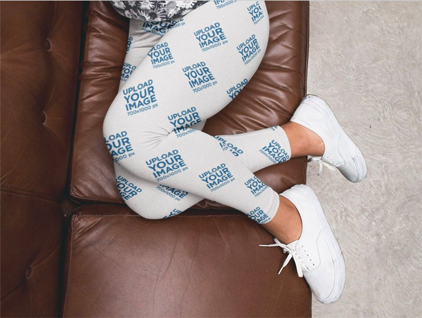 Woman Legs Wearing Leggings Mockup and White Shoes on a Brown Sofa