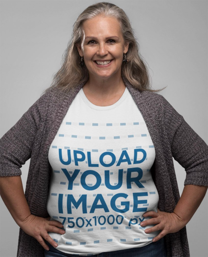 T-Shirt Mockup of a Smiling Senior Lady with Hands on Her Waist