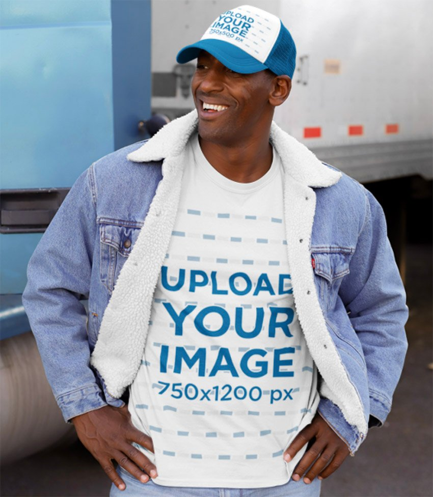Mockup of a Man Wearing a Customizable T-Shirt and Trucker Hat in the Street