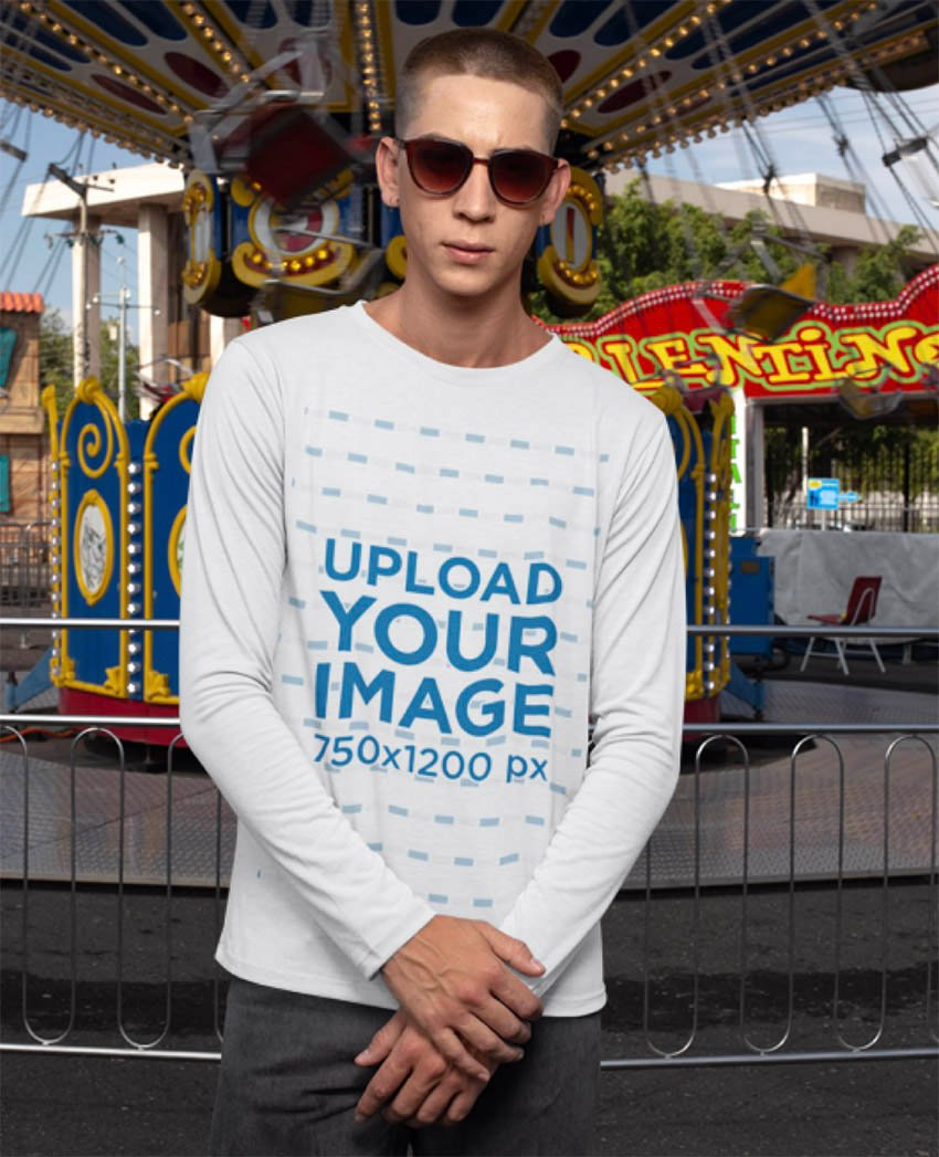 Long Sleeve T-Shirt Mockup of a Man Standing in Front of a Swing Carousel Ride