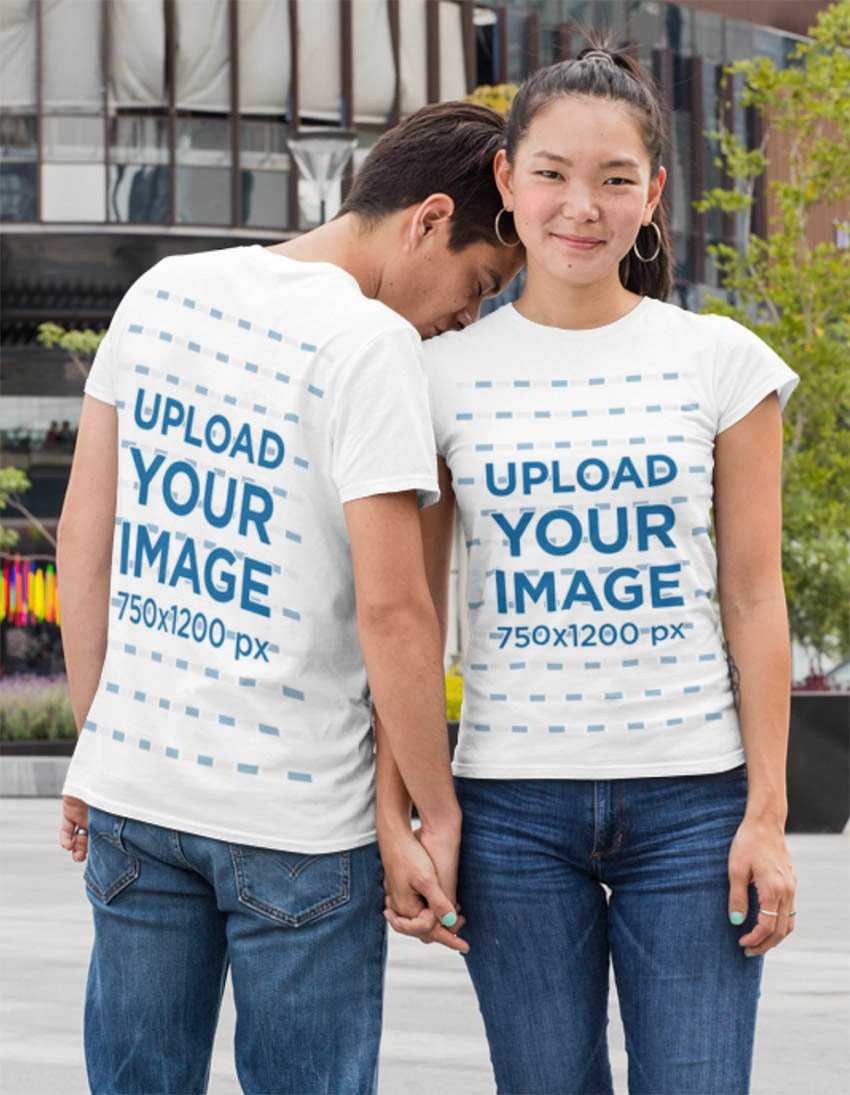 Mockup of a Couple Wearing T-Shirts in the City
