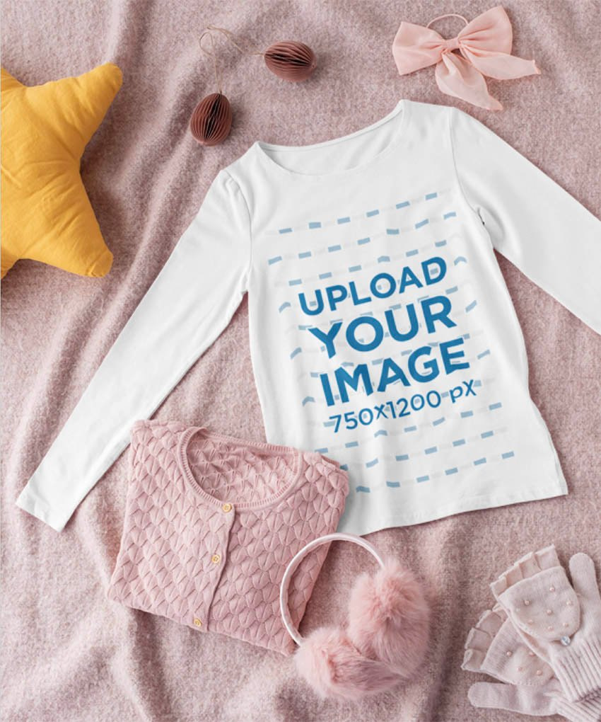 Mockup of a Long Sleeve Tee for a Girl Lying on a Textured Surface