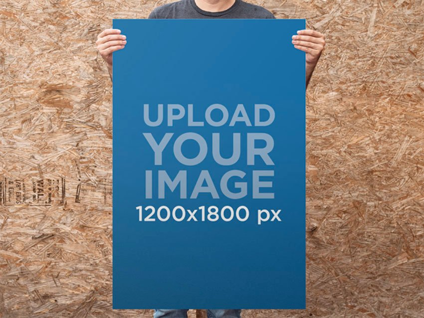 Guy Standing in Front of a Wooden Wall Holding a Poster Mockup